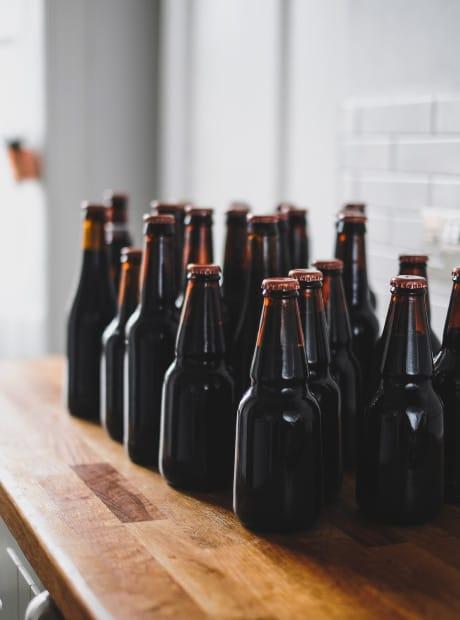 Bunch of beer bottles on a desk